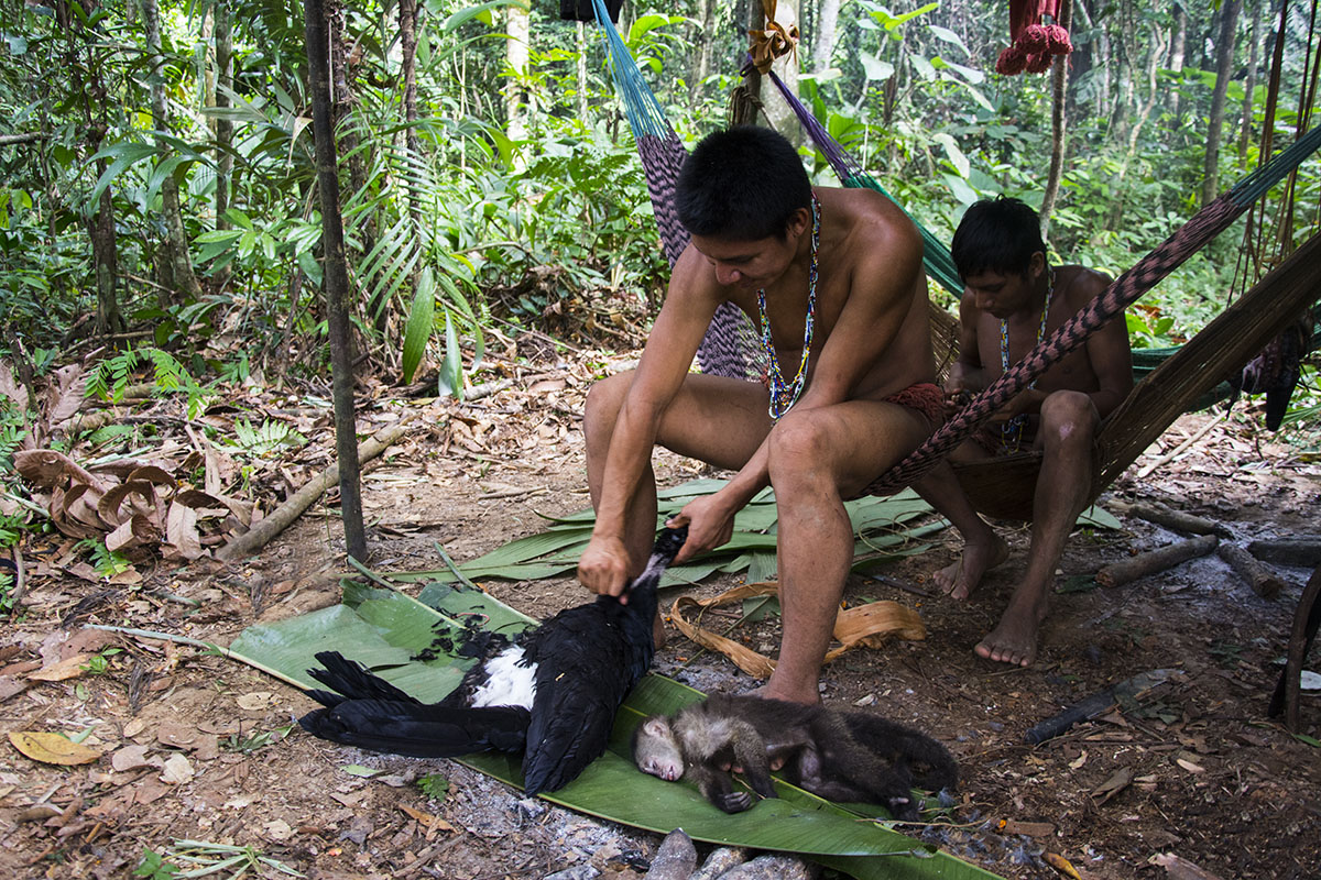 <p>Our guides making the supper in the camp on Rio Yuri during crossing of Sierra Maigualida. Venezuela.</p>